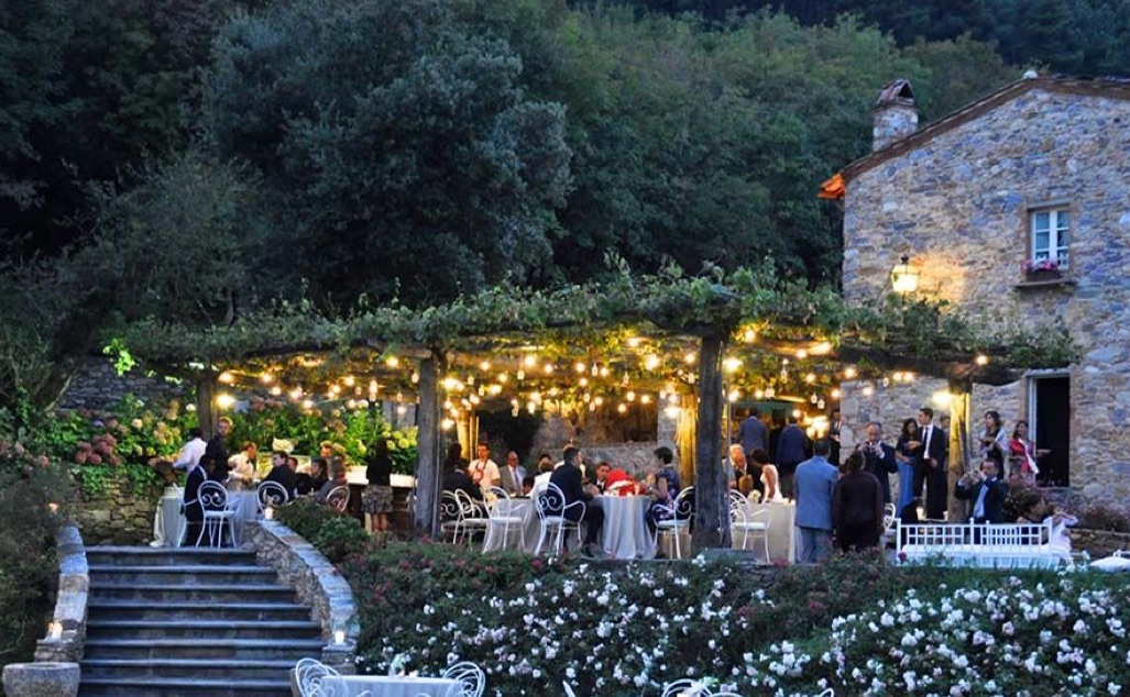 Candlelit covered patio with diners